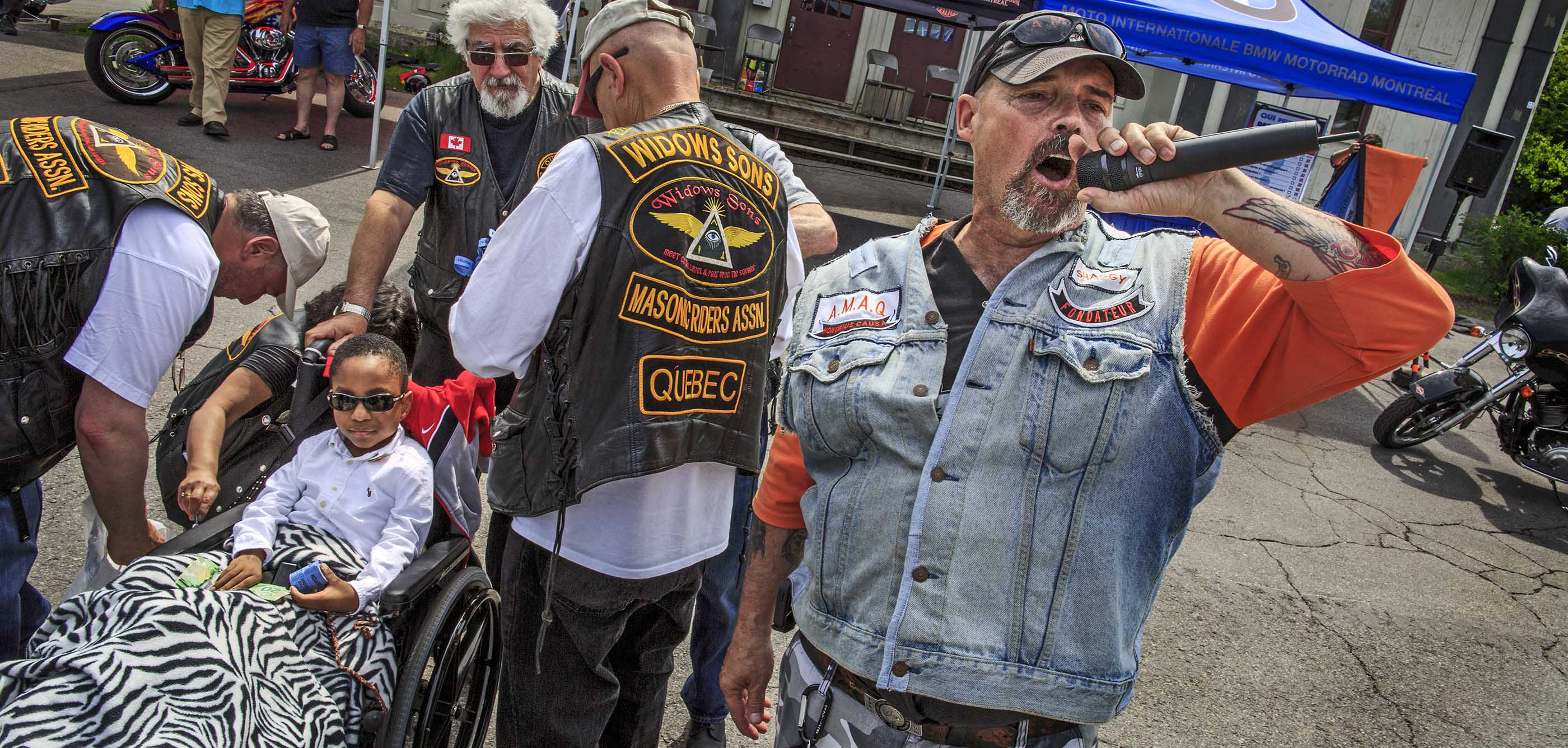 BIKERS JESUS PRAYER PRIEST MONTREAL CHILDREN FREEMASSONS MOTOCYCLES BIKES TATOOS STORY HOSPITAL RIDE WIDOWS SONS Photoreport MICHAEL MONNIER